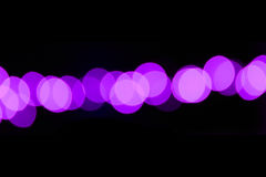 Abstract Background Purple Dot Effect. An abstract background featuring purple and black colors resembling out of focus dots Royalty Free Stock Photos