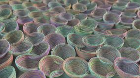 Abstract background from purple, green, blue and orange spiraled coils. Colorful wires with depth of field. 3D rendering illustration Stock Photos