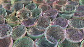 Abstract background from purple, green, blue and orange spiraled coils. Colorful wires with depth of field. 3D rendering illustration Royalty Free Stock Photos