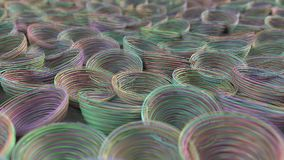 Abstract background from purple, green, blue and orange spiraled coils. Colorful wires with depth of field. 3D rendering illustration Stock Photography