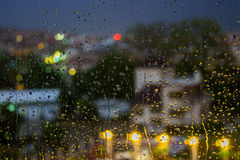 Abstract background raindrops on  blurred lights background Royalty Free Stock Photos