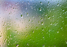 Abstract background with raindrops on glass. Stock Image