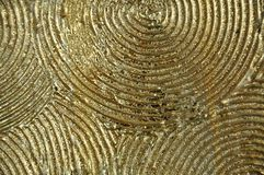 Abstract background of raised golden ridges of concentric circles stock photos