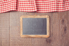 Abstract background with red checked tablecloth and chalkboard. View from above Royalty Free Stock Photo
