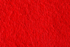 Abstract background with red felt texture, velvet fabric. High res macro photo Royalty Free Stock Photography