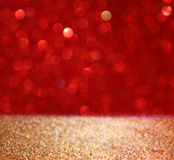 Abstract background of red and gold glitter bokeh lights, defocused