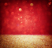 Abstract background of red and gold glitter bokeh lights, defocused royalty free stock photos