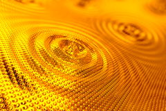 Abstract background of ripples in gold Stock Image