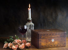 Abstract background with roses, jewelry box, candle and wine gla Royalty Free Stock Images