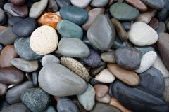 Abstract background with round wet pebble stones. Royalty Free Stock Photography