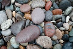 Abstract background with round wet pebble stones Stock Image