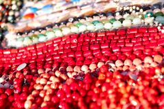 Abstract background. Samples of colored women`s beads from natural and artificial stone stock images