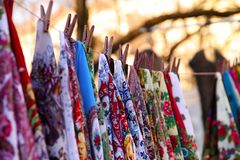 Abstract background. Samples of colorful women`s scarves on the head against the bokeh background. royalty free stock photos
