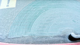 Abstract background. Screen wiper traces on frostiness car glass Stock Photos