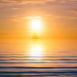 Abstract background with sea sunrise and yacht. On horizon Royalty Free Stock Image