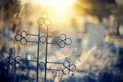 Abstract background with a sepulchral cross. At the cemetery Royalty Free Stock Image