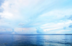 Abstract background shades colors of blue ocean, sky & clouds Stock Images