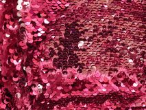 Abstract background of shiny red sequins royalty free stock photography