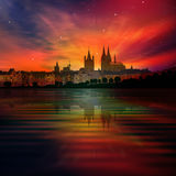 Abstract background with silhouette of Cologne and sunset. Abstract background with red sunset and silhouette of Koln Royalty Free Stock Images