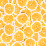 Abstract background with slices of fresh grapefruit. Seamless pattern for design. Close-up. Studio photography. Stock Image