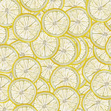 Abstract background with slices of fresh lemon. Seamless pattern for a design. Close-up. Studio photography. Stock Image