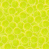 Abstract background with slices of fresh limes. Seamless pattern for design. Close-up. Studio photography. Royalty Free Stock Photography