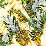 Abstract background with slices of fresh pineapple. Seamless pattern for a design. Close-up. Stock Photo