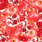 Abstract background with slices of fresh pomegranate. Seamless pattern for a design. Close-up. Royalty Free Stock Photos