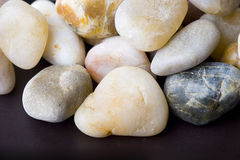 Abstract background of small colorful pebble stone. S over brown stock photo