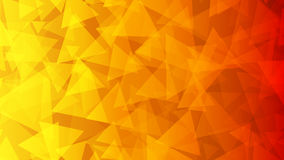 Abstract background of small triangles. In red, orange and yellow colors Stock Photo