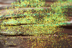 Abstract background with sparkle colorful glitter. Creative abstract dark brown art background with sparkle colorful glitter. Melted smeared chocolate for food Royalty Free Stock Photography