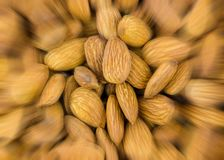 Abstract background speed blur acceleration nut almond culinary pattern closeup brown delicious snack stock photo