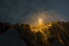 Abstract background from spinning steel wool on cliff at night t Stock Images