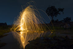 Abstract background from spinning steel wool  at night time Royalty Free Stock Image