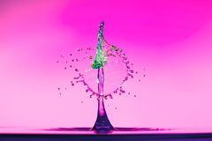 Abstract background of splash of color water, collision of colored drops. The concept art stock photos