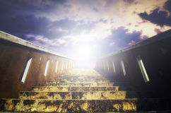 Stairs to the sky, light beam effect and cloudy background Stock Photos