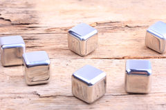 Abstract background. steel cubes on a wooden surface Royalty Free Stock Image