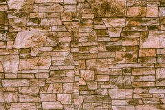 Abstract background of stone masonry. Abstract background of red chipped stone Stock Images