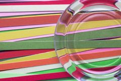 Strips of colored quilling paper. Abstract background. Strips of colored paper. Multicolored stripes. Distortion of lines through glass. Bright background Stock Images
