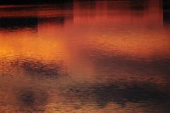 Abstract background. Sunset sky reflected in water. stock image