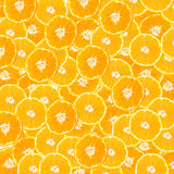Abstract background with tangerine slices. Seamless pattern for design. Close-up. Studio photography. Royalty Free Stock Photography