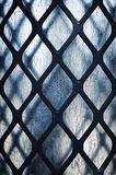 Detail of a black iron grid. Abstract background or texture detail of a black iron grid Royalty Free Stock Images