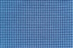 Texture of fabric with small checkered design Stock Images