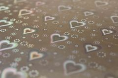 Abstract background texture with hearts. Conceptual background for Valentine`s Day. Selective focus stock photo