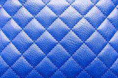 Proton purple colored leather texture with rhombus. Background for sofa interior or door. stock images