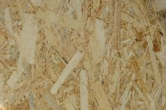 Abstract background texture of Wood chips felted brown color OSB. Stock Photo