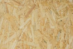Abstract background texture of Wood chips felted brown color OSB. Royalty Free Stock Photo
