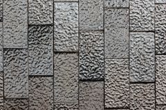 Abstract background of textured black and white shiny ceramic tiles.  stock photos