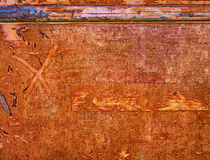 Abstract Background of Textured Paint. An abstract textured background in intense colors of rust, red, and orange with blue and pink, which is in fact the rusted royalty free stock photos