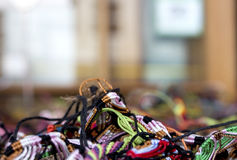 Group of leather and silk threads. Colorful mix of threads, selective focus Stock Photos